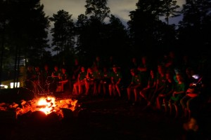 Campers gather around the campfire in the evening at Youth Camp, 2013.