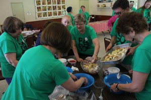 Campers learn how to prepare and transport food for dinner on the grounds at Adult Camp, 2013.