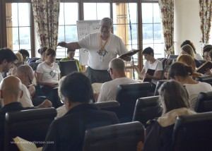 Sacred Harp composer P. Dan Brittain leads a song during a class at Europe Camp, 2012.