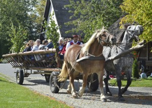 Touring Chmielno in a Kashubian haycart at Europe Camp 2012.